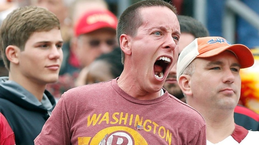 Oct 25, 2015; Landover, MD, USA; A Washington Redskins fan yells at the Redskins bench from the stands against the Tampa Bay Buccaneers in the second quarter at FedEx Field. Mandatory Credit: Geoff Burke-USA TODAY Sports