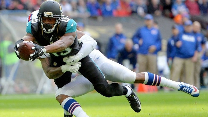 Oct 25, 2015; London, United Kingdom; Jacksonville Jaguars receiver Allen Robinson (15) is defended by Buffalo Bills cornerback Stephon Gilmore (24) on a 10-yard touchdown reception in the first quarter during NFL International Series game at Wembley Stadium. Mandatory Credit: Kirby Lee-USA TODAY Sports