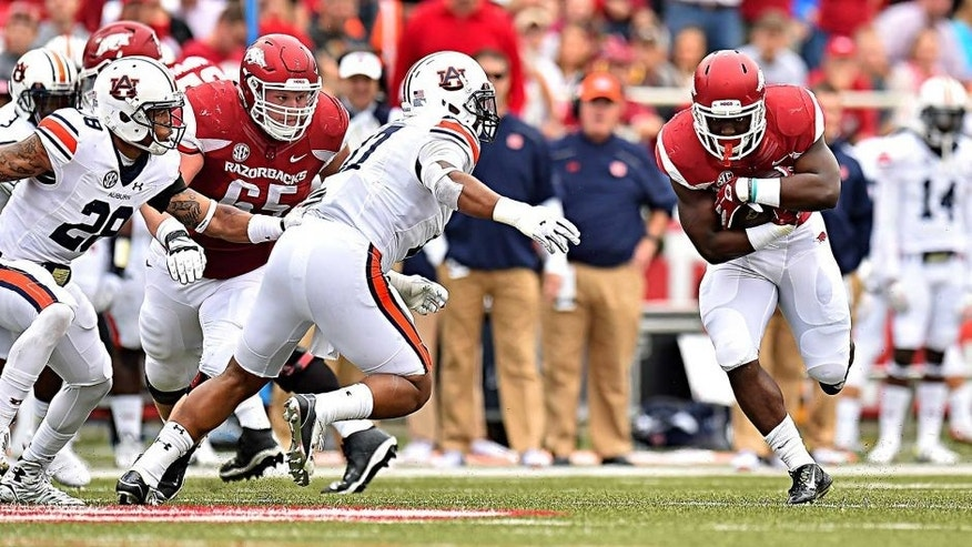 Oct 24, 2015; Fayetteville, AR, USA; Arkansas Razorbacks running back Rawleigh Williams (22) runs the ball against the Auburn Tigers during the first half at Donald W. Reynolds Razorback Stadium. Mandatory Credit: Jasen Vinlove-USA TODAY Sports
