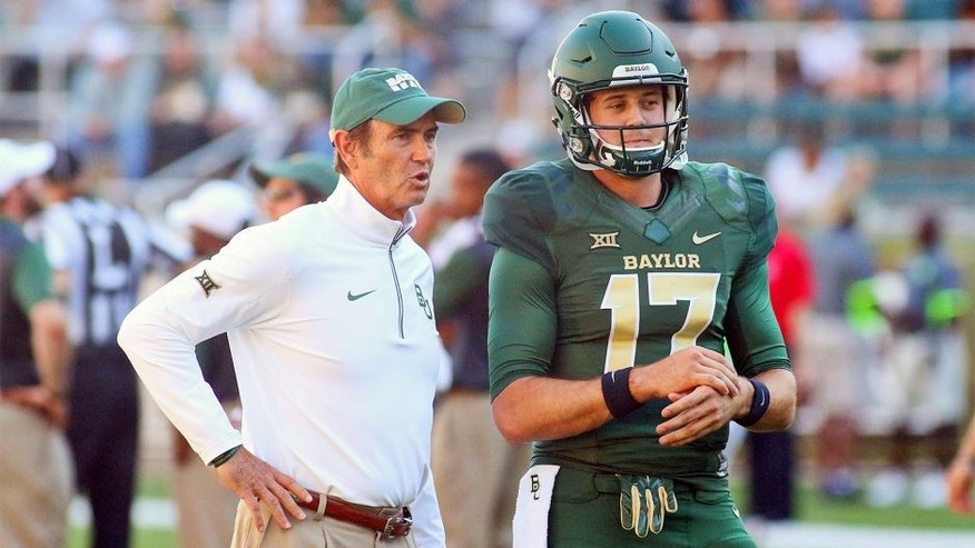 Sep 12, 2015; Waco, TX, USA; Baylor Bears head coach Art Briles and quarterback Seth Russell (17) prior to a game against the Lamar Cardinals at McLane Stadium. Baylor 66-31. Mandatory Credit: Ray Carlin-USA TODAY Sports