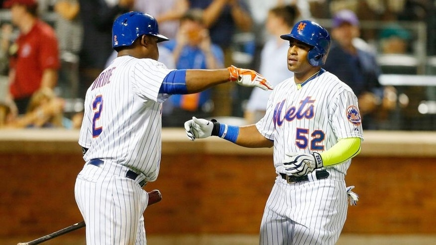 NEW YORK, NY - AUGUST 12: Yoenis Cespedes #52 of the New York Mets celebrates his eighth-inning home run against the Colorado Rockies with teammate Juan Uribe #2 at Citi Field on August 12, 2015 in the Flushing neighborhood of the Queens borough of New York City. (Photo by Jim McIsaac/Getty Images)