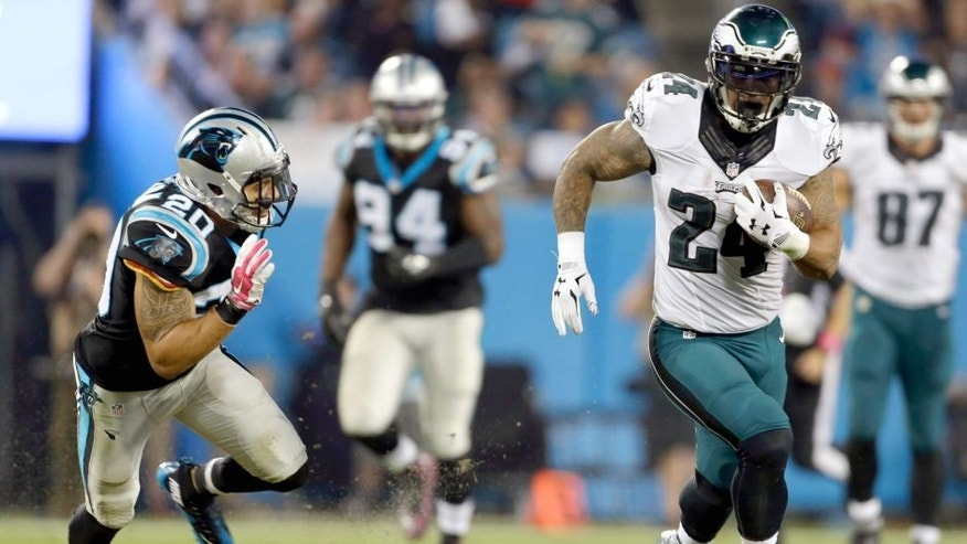Philadelphia Eagles' Ryan Mathews (24) runs past Carolina Panthers' Kurt Coleman (20) for a touchdown in the second half of an NFL football game in Charlotte, N.C., Sunday, Oct. 25, 2015. (AP Photo/Bob Leverone)