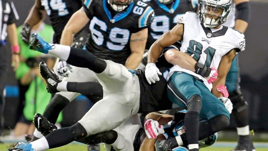 Carolina Panthers' Colin Jones, bottom, recovers the ball as Philadelphia Eagles' Jordan Matthews, right, is tackled in the first half of an NFL football game in Charlotte, N.C., Sunday, Oct. 25, 2015. The Panthers recovered the Matthews fumble. (AP Photo/Bob Leverone)