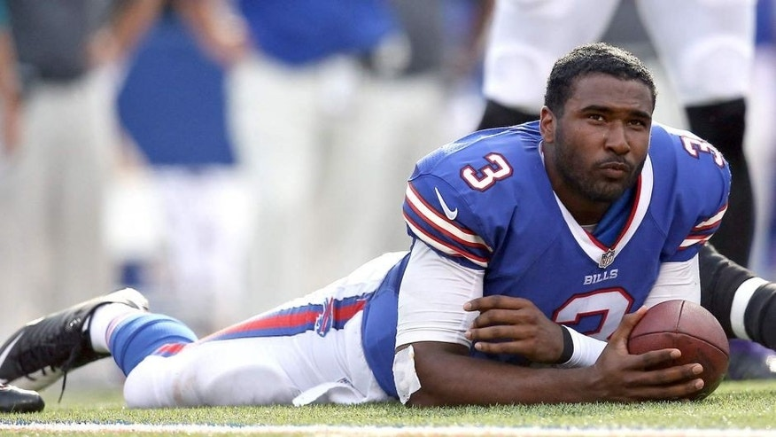 ORCHARD PARK, NY - SEPTEMBER 29: E.J. Manuel #3 of the Buffalo Bills looks on after having his helmet knocked off during NFL game action by Terrell Suggs #55 of the Baltimore Ravens at Ralph Wilson Stadium on September 29, 2013 in Orchard Park, New York. (Photo by Tom Szczerbowski/Getty Images)