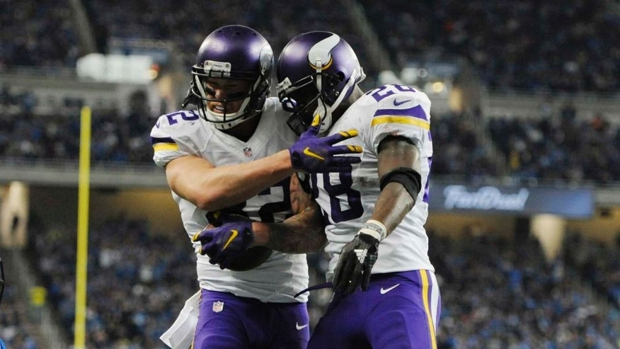 Minnesota Vikings tight end Kyle Rudolph (left) celebrates his touchdown with teammate Adrian Peterson during the first half against the Detroit Lions on Sunday, Oct. 25, 2015, in Detroit.