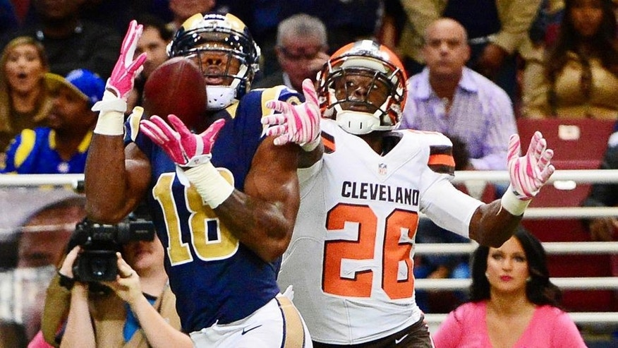 Oct 25, 2015; St. Louis, MO, USA; St. Louis Rams wide receiver Kenny Britt (18) catches a pass in the end zone as Cleveland Browns cornerback Pierre Desir (26) defends during the second half at the Edward Jones Dome. The Rams won 24-6. Mandatory Credit: Jeff Curry-USA TODAY Sports