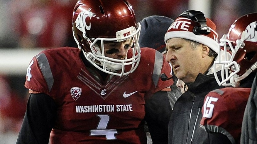 Nov 29, 2014; Pullman, WA, USA; Washington State Cougars head coach Mike Leach talks with quarterback Luke Falk (4) during a game against the Washington Huskies during the second half at Martin Stadium. Huskies won 31-13. Mandatory Credit: James Snook-USA TODAY Sports
