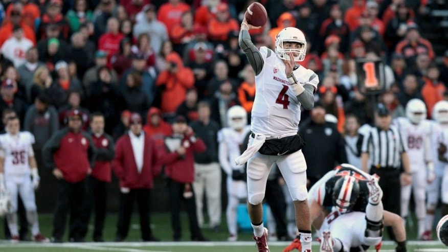 Nov 8, 2014; Corvallis, OR, USA; Washington State Cougars quarterback Luke Falk (4) throws the ball in the second half against the Oregon State Beavers at Reser Stadium. Mandatory Credit: Scott Olmos-USA TODAY Sports