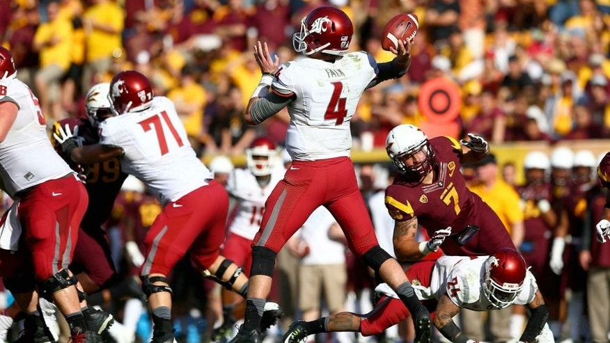 Nov 22, 2014; Tempe, AZ, USA; Washington State Cougars quarterback Luke Falk (4) throws a pass in the fourth quarter against the Arizona State Sun Devils at Sun Devil Stadium. The Sun Devils defeats the Cougars 52-31. Mandatory Credit: Mark J. Rebilas-USA TODAY Sports