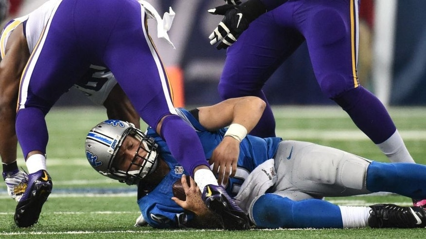 Oct 25, 2015; Detroit, MI, USA; Detroit Lions quarterback Matthew Stafford (9) is sacked during the second quarter against the Minnesota Vikings at Ford Field. Mandatory Credit: Tim Fuller-USA TODAY Sports