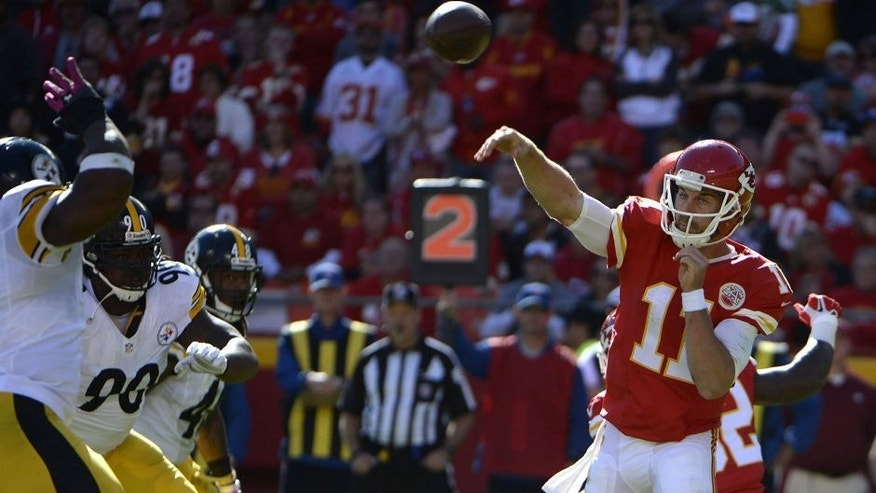 Oct 25, 2015; Kansas City, MO, USA; Kansas City Chiefs quarterback Alex Smith (11) throws a pass against the Pittsburgh Steelers in the second half at Arrowhead Stadium. Kansas City won 23-13. Mandatory Credit: John Rieger-USA TODAY Sports