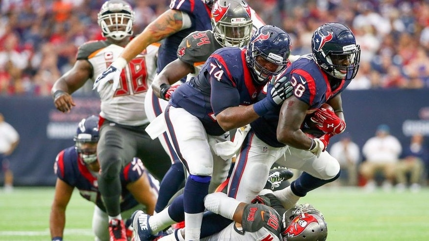 Sep 27, 2015; Houston, TX, USA; Houston Texans running back Alfred Blue (28) runs over Tampa Bay Buccaneers free safety Bradley McDougald (30) during the first half at NRG Stadium. Mandatory Credit: Kevin Jairaj-USA TODAY Sports