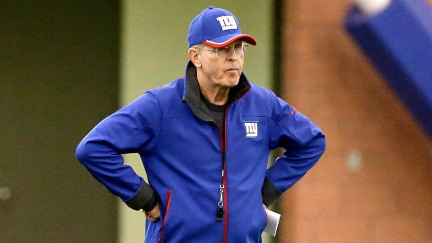 New York Giants head coach Tom Coughlin walks on the field during organized team activity in East Rutherford, N.J., Monday, June 1, 2015. (AP Photo/Seth Wenig)