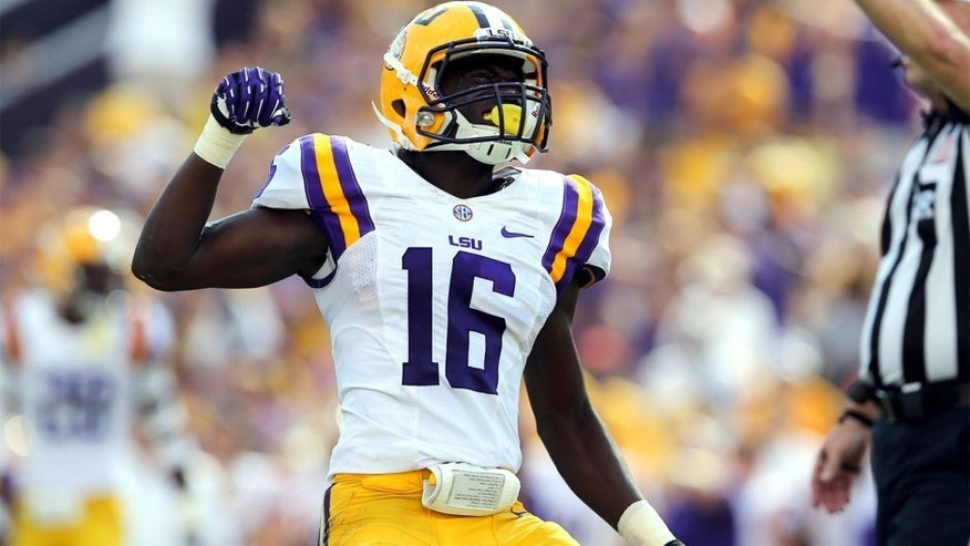 Oct 12, 2013; Baton Rouge, LA, USA; LSU Tigers defensive back Tre'Davious White (16) celebrates a play during the second quarter of their game against the Florida Gators at Tiger Stadium. Mandatory Credit: Chuck Cook-USA TODAY Sports
