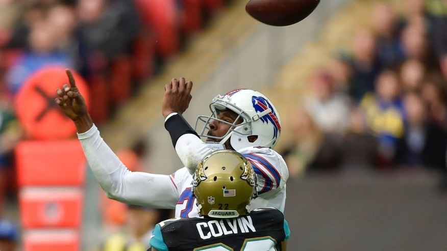 Oct 25, 2015; London, United Kingdom; Jacksonville Jaguars cornerback Aaron Colvin (22) hits Buffalo Bills quarterback EJ Manuel (3) to force a fumble during the first half of the game at Wembley Stadium. Mandatory Credit: Steve Flynn-USA TODAY Sports