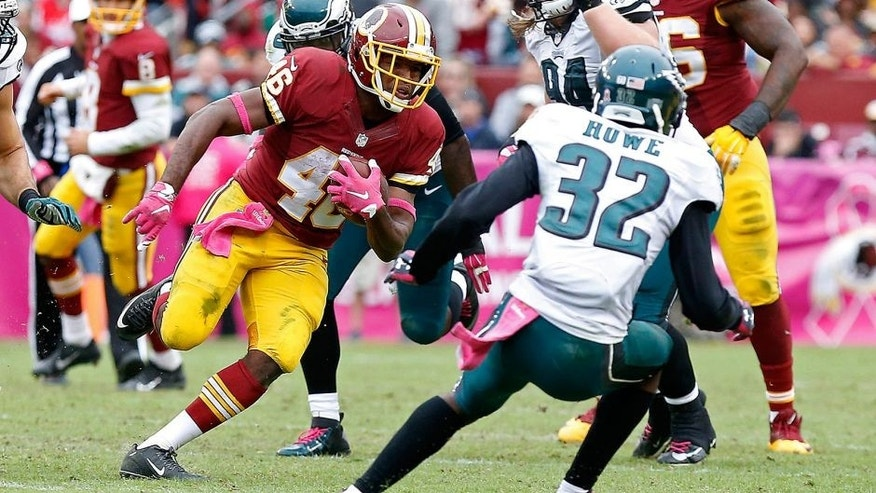 Oct 4, 2015; Landover, MD, USA; Washington Redskins running back Alfred Morris (46) carries the ball as Philadelphia Eagles cornerback Eric Rowe (32) attempts the tackle in the fourth quarter at FedEx Field. The Redskins won 23-20. Mandatory Credit: Geoff Burke-USA TODAY Sports