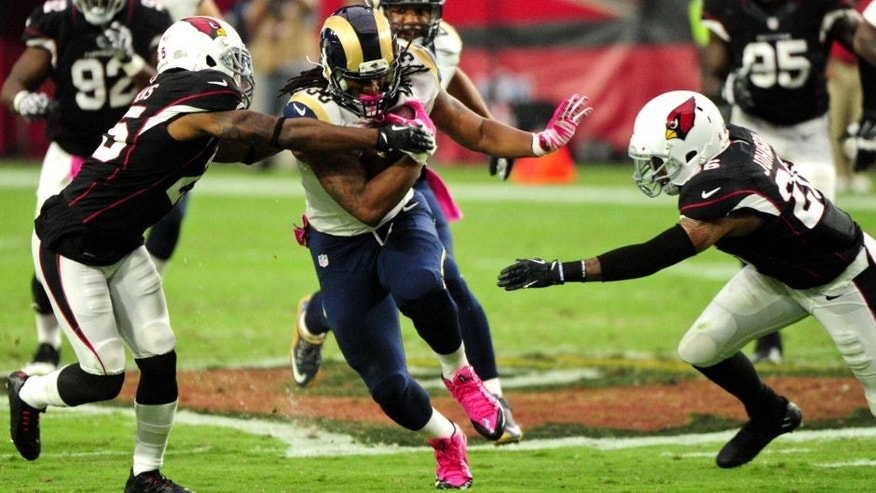 Oct 4, 2015; Glendale, AZ, USA; St. Louis Rams running back Todd Gurley (30) breaks tackles by Arizona Cardinals cornerback Jerraud Powers (25) and free safety Rashad Johnson (26) during the second half at University of Phoenix Stadium. Mandatory Credit: Matt Kartozian-USA TODAY Sports