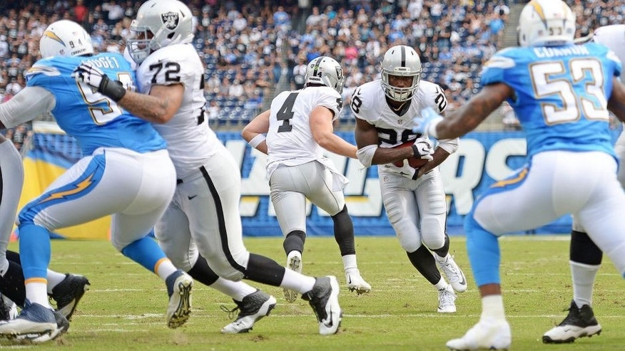Oct 25, 2015; San Diego, CA, USA; Oakland Raiders running back Latavius Murray (28) runs for a touchdown during the first quarter against the San Diego Chargers at Qualcomm Stadium. Mandatory Credit: Jake Roth-USA TODAY Sports