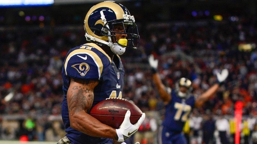 Nov 24, 2013; St. Louis, MO, USA; St. Louis Rams wide receiver Tavon Austin (11) carries the ball for a 65 yard touchdown during the first half against the Chicago Bears at the Edward Jones Dome. Mandatory Credit: Jeff Curry-USA TODAY Sports