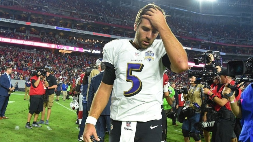 Baltimore Ravens quarterback Joe Flacco walks off the field after losing the game on an interception on Monday, Oct. 26, 2015, at the University of Phoenix Stadium in Glendale, Ariz. (Lloyd Fox/Baltimore Sun/TNS via Getty Images)