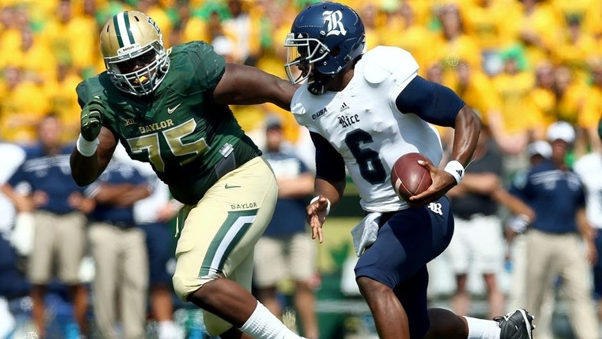 WACO, TX - SEPTEMBER 26: Driphus Jackson #6 of the Rice Owls carries the ball against Andrew Billings #75 of the Baylor Bears in the first quarter at McLane Stadium on September 26, 2015 in Waco, Texas. (Photo by Tom Pennington/Getty Images)