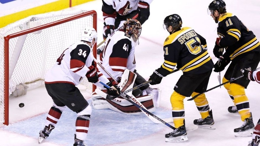 Boston Bruins right wing Jimmy Hayes (11) scores on Arizona Coyotes goalie Mike Smith (41) during the second period of an NHL hockey game in Boston, Tuesday, Oct. 27, 2015. (AP Photo/Charles Krupa)