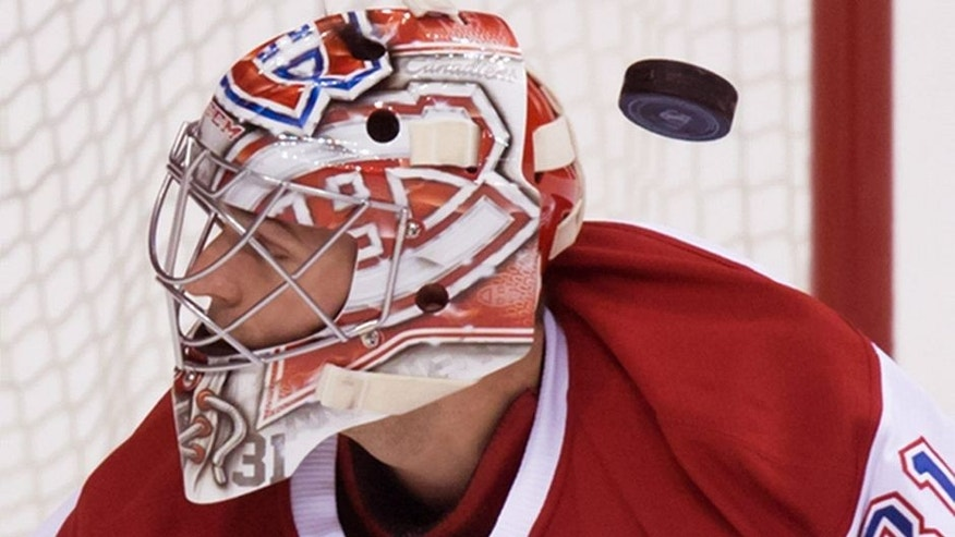 "<p style=""font-family: tahoma, arial, helvetica, sans-serif; font-size: 12px;"">The puck deflects off the glove of Montreal Canadiens' goalie Carey Price and drops behind him before being put in the net by Vancouver Canucks' Jared McCann, not pictured, for a goal during the first period of an NHL hockey game in Vancouver, British Columbia, Tuesday, Oct. 27, 2015. (Darryl Dyck/The Canadian Press via AP) MANDATORY CREDIT</p>"