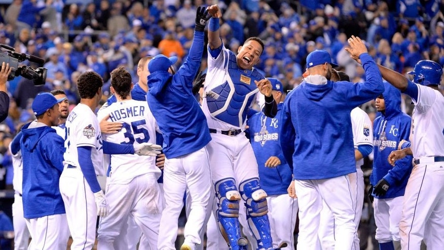 KANSAS CITY, MO - OCTOBER 27: Members of the Kansas City Royals celebrate defeating the New York Mets in Game 1 of the 2015 World Series at Kauffman Stadium on Tuesday, October 27, 2015 in Kansas City, Missouri. (Photo by Ron Vesely/MLB Photos via Getty Images)