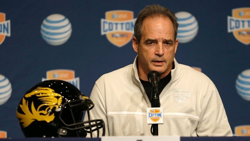 <p>Missouri coach Gary Pinkel answers questions from reporters during the AT&T Cotton Bowl Classic media day on Monday, Dec. 30, 2013, in Arlington, Texas. Missouri will play Oklahoma State in the annual bowl game on Friday.</p>
