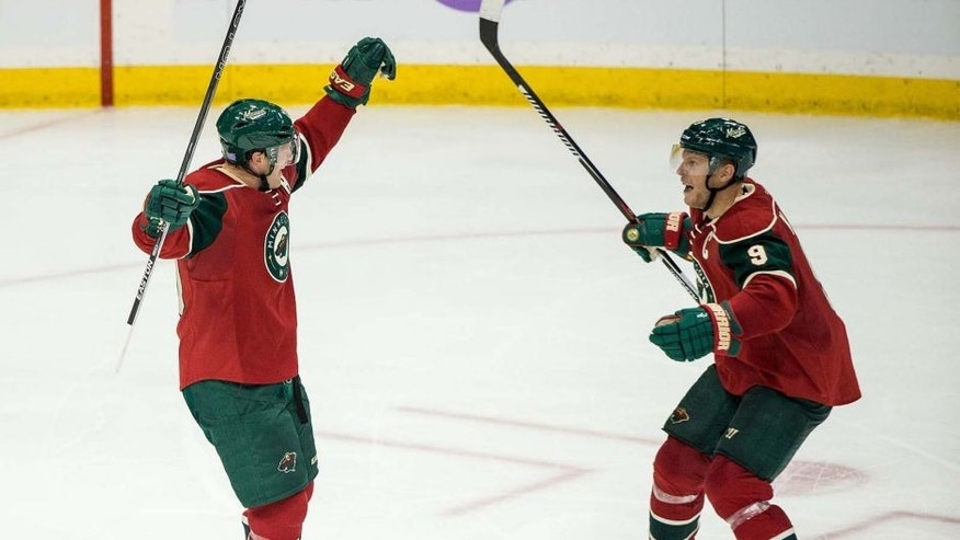 Minnesota Wild defenseman Ryan Suter (left) celebrates his goal with forward Mikko Koivu during the third period of the Wild's 4-3 win against the Edmonton Oilers at Xcel Energy Center on Tuesday, Oct. 27, 2015.