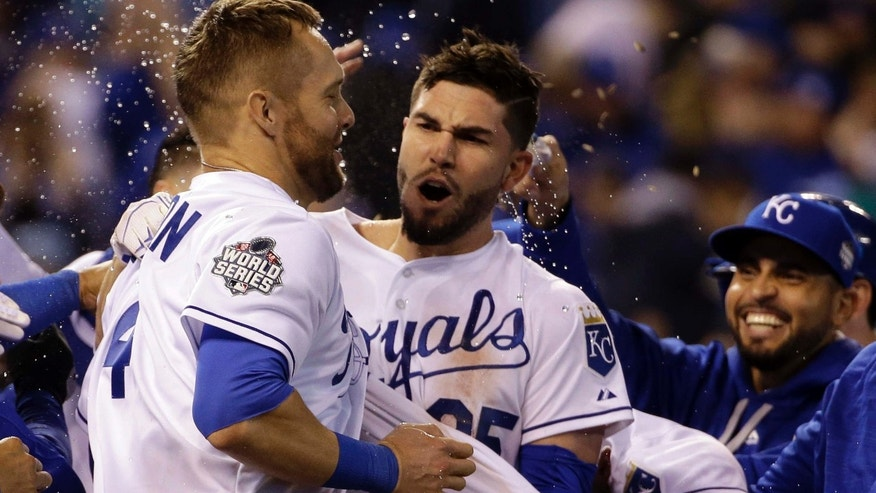 Oct. 28, 2015: Kansas City Royals' Eric Hosmer is congratulated by teammates after hitting the game-winning sacrifice fly during the 14th inning of Game 1 of the Major League Baseball World Series against the New York Mets in Kansas City, Mo.