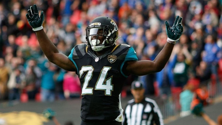 LONDON, ENGLAND - OCTOBER 25: TJ Yeldon #24 of Jacksonville Jaguars celebrates scoring a touchdown during the NFL game between Jacksonville Jaguars and Buffalo Bills at Wembley Stadium on October 25, 2015 in London, England. (Photo by Alan Crowhurst/Getty Images)