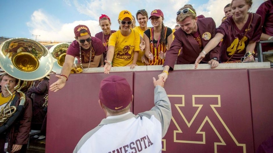 Sep 20, 2014; Minneapolis, MN, USA; Minnesota Golden Gophers head coach Jerry Kill shakes hands with some fans after the game against the San Jose State Spartans at TCF Bank Stadium. The Gophers won 24-7. Mandatory Credit: Jesse Johnson-USA TODAY Sports