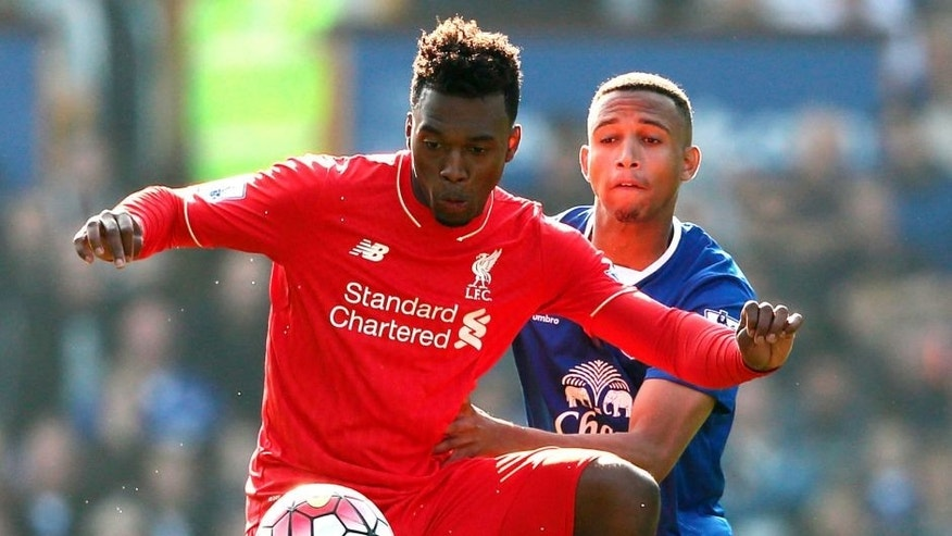 LIVERPOOL, ENGLAND - OCTOBER 04: Daniel Sturridge of Liverpool and Brendan Galloway of Everton during the Barclays Premier League match between Everton and Liverpool at Goodison Park on October 04, 2015 in Liverpool, England. (Photo by Matthew Ashton - AMA/Getty Images)