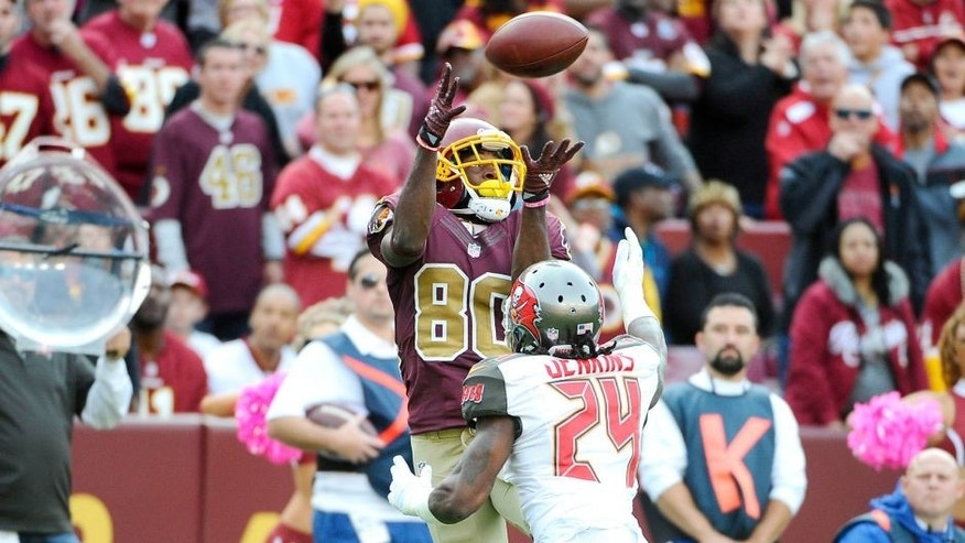 Oct 25, 2015; Landover, MD, USA; Washington Redskins wide receiver Jamison Crowder (80) makes a reception over Tampa Bay Buccaneers cornerback Mike Jenkins (24) during the second half at FedEx Field. The Washington Redskins won 31 - 30. Mandatory Credit: Brad Mills-USA TODAY Sports