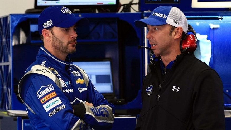Feb 13, 2015; Daytona Beach, FL, USA; NASCAR Sprint Cup Series driver Jimmie Johnson (48) and his crew chief Chad Knaus during practice for the The Sprint Unlimited at Daytona International Speedway. Mandatory Credit: Andrew Weber-USA TODAY Sports