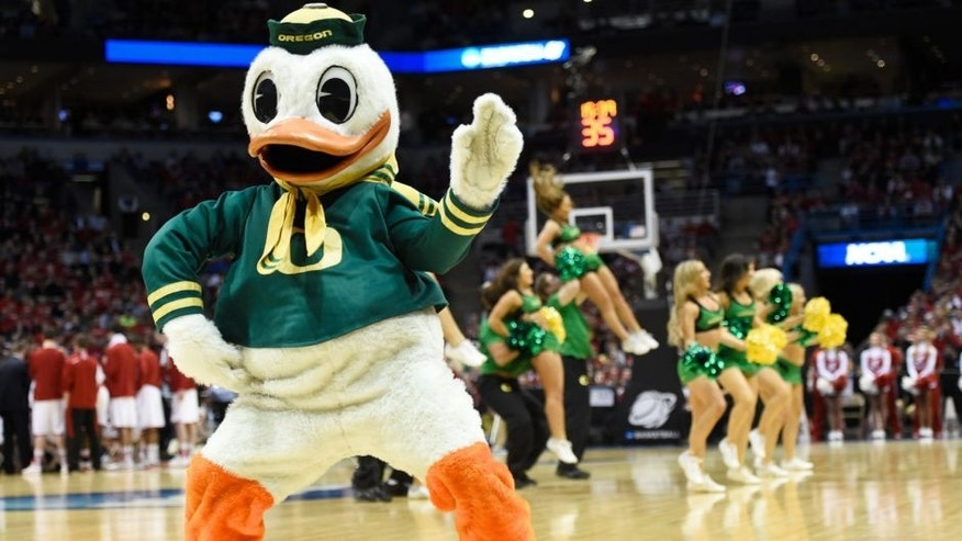<p>Mar 22, 2014; Milwaukee, WI, USA; Oregon Ducks mascot The Oregon Duck dances in the first half of a men's college basketball game against the Wisconsin Badgers during the third round of the 2014 NCAA Tournament at BMO Harris Bradley Center.</p>