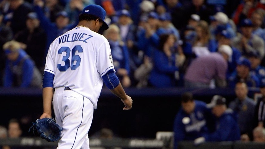 Oct 27, 2015; Kansas City, MO, USA; Kansas City Royals starting pitcher Edinson Volquez (36) walks back to the dugout after retiring the New York Mets in the fourth inning in game one of the 2015 World Series at Kauffman Stadium. Mandatory Credit: John Rieger-USA TODAY Sports