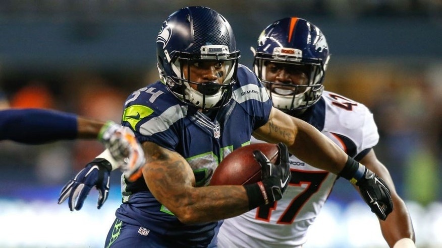 SEATTLE, WA - AUGUST 14: Running back Thomas Rawls #34 of the Seattle Seahawks rushes for a touchdown in the fourth quarter against the Denver Broncos at CenturyLink Field on August 14, 2015 in Seattle, Washington. The Broncos defeated the Seahawks 22-20. (Photo by Otto Greule Jr/Getty Images)