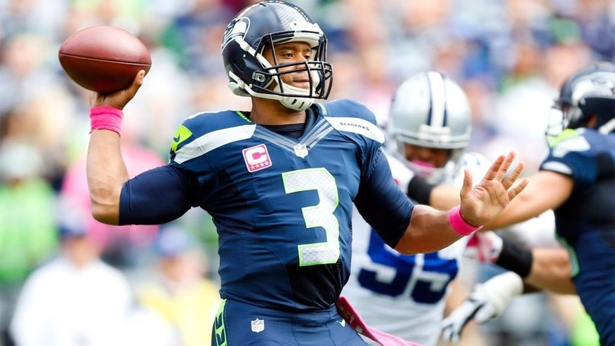 Oct 12, 2014; Seattle, WA, USA; Seattle Seahawks quarterback Russell Wilson (3) passes against the Dallas Cowboys during the first quarter at CenturyLink Field. Mandatory Credit: Joe Nicholson-USA TODAY Sports
