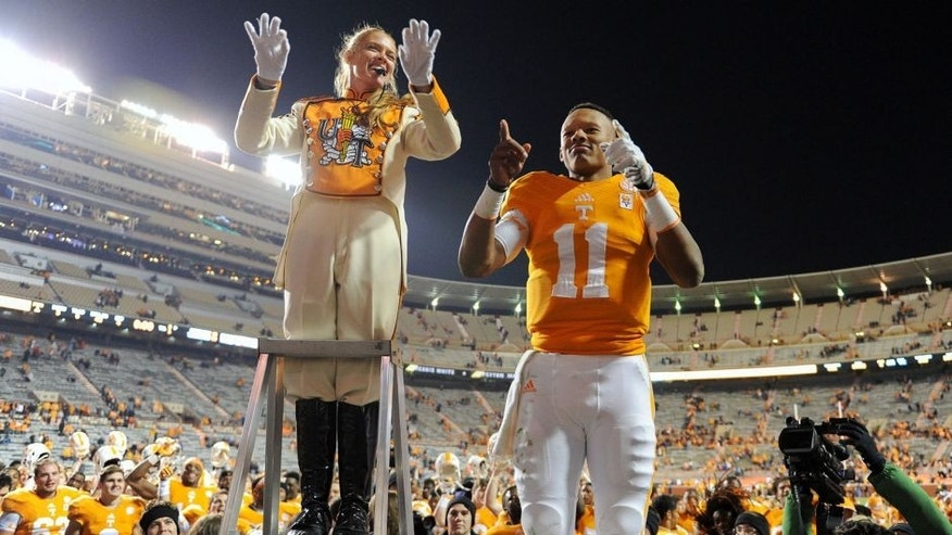 Nov 15, 2014; Knoxville, TN, USA; Tennessee Volunteers quarterback Joshua Dobbs (11) leads the band after the game against the Kentucky Wildcats at Neyland Stadium. Tennessee won 50 to 16. Mandatory Credit: Randy Sartin-USA TODAY Sports