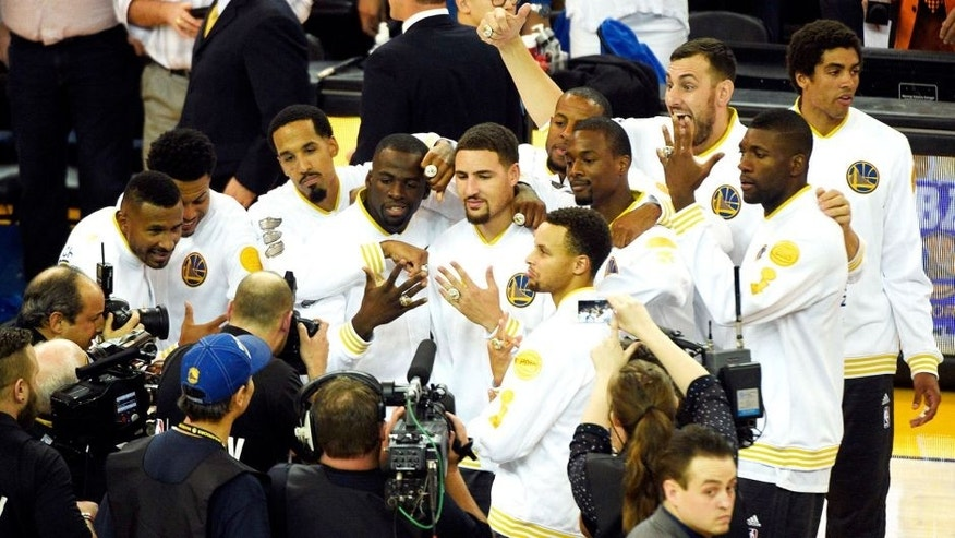 Oct 27, 2015; Oakland, CA, USA; The Golden State Warriors celebrate receiving their 2014-2015 NBA Championship rings before the game against the New Orleans Pelicans at Oracle Arena. Mandatory Credit: Kyle Terada-USA TODAY Sports