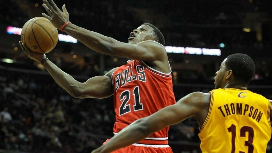 Jan 22, 2014; Cleveland, OH, USA; Chicago Bulls shooting guard Jimmy Butler drives against Cleveland Cavaliers power forward Tristan Thompson (13) in the first quarter at Quicken Loans Arena. Mandatory Credit: David Richard-USA TODAY Sports