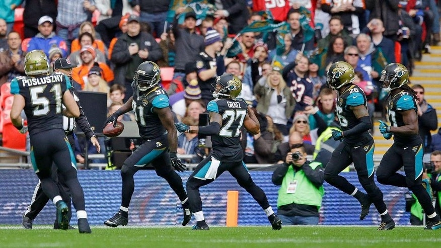 Jacksonville Jaguars defensive end Chris Clemons (91), second left reacts after scoring a touchdown during the NFL game between Buffalo Bills and Jacksonville Jaguars at Wembley Stadium in London, Sunday, Oct. 25, 2015. (AP Photo/Matt Dunham)