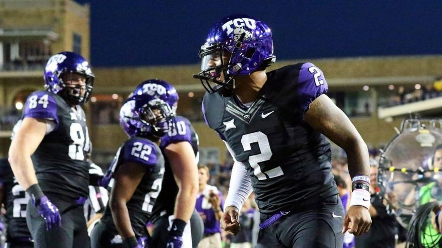 Oct 29, 2015; Fort Worth, TX, USA; TCU Horned Frogs quarterback Trevone Boykin (2) celebrates his touchdown run against the West Virginia Mountaineers during the first quarter of a game at Amon G. Carter Stadium. Mandatory Credit: Ray Carlin-USA TODAY Sports