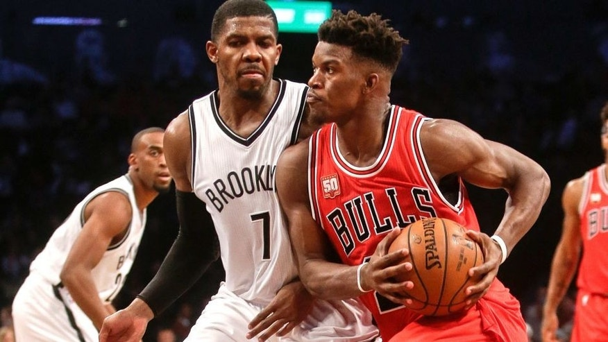Brooklyn Nets' Joe Johnson (7) defends Chicago Bulls' Jimmy Butler (21) during the second half of an NBA basketball game Wednesday, Oct. 28, 2015, in New York. The Bulls won 115-100. (AP Photo/Frank Franklin II)