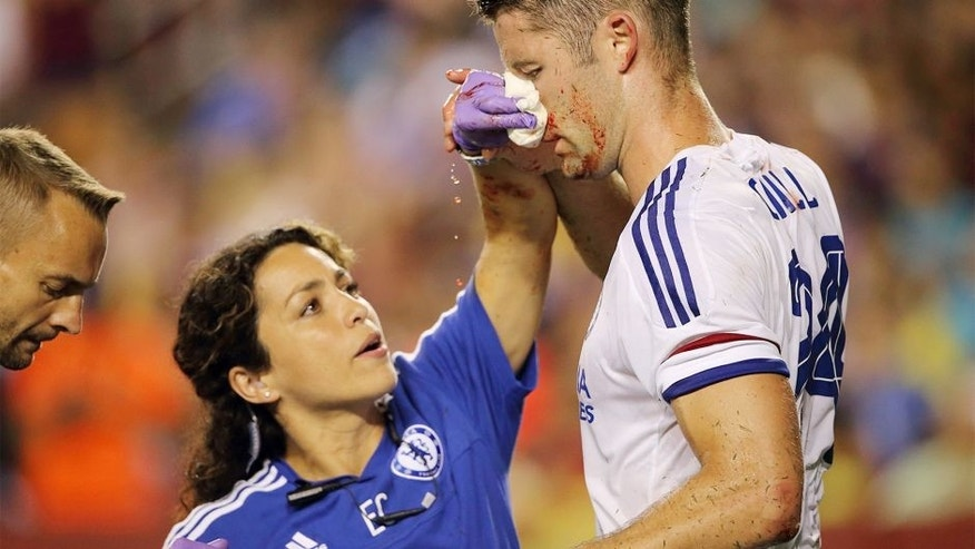 LANDOVER, MD - JULY 28: Chelsea first-team doctor Eva Carneiro attends to Gary Cahill of Chelsea who suffered a bloody nose following scoring the goal which tied the game 2-2 during the International Champions Cup match between Barcelona and Chelsea at FedExField on July 28, 2015 in Landover, Maryland. (Photo by Matthew Ashton - AMA/Getty Images)