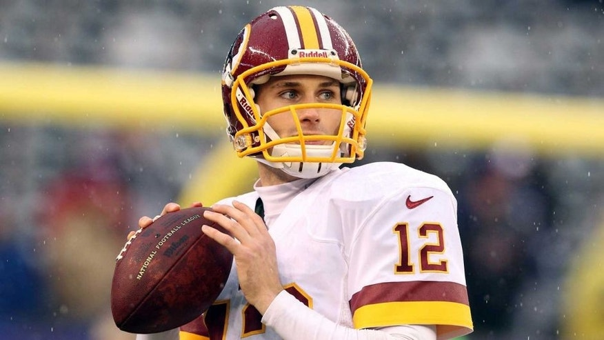 Dec 29, 2013; East Rutherford, NJ, USA; Washington Redskins quarterback Kirk Cousins (12) warms up before a game against the New York Giants at MetLife Stadium. Mandatory Credit: Brad Penner-USA TODAY Sports