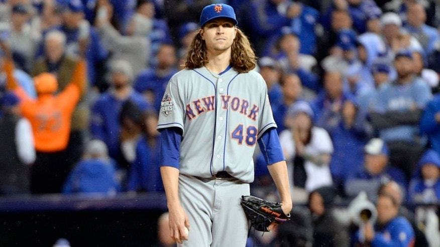 KANSAS CITY, MO - OCTOBER 28: Jacob deGrom #48 of the New York Mets looks on against the Kansas City Royals during Game 2 of the 2015 World Series at Kauffman Stadium on Wednesday, October 28, 2015 in Kansas City, Missouri. (Photo by Ron Vesely/MLB Photos via Getty Images)