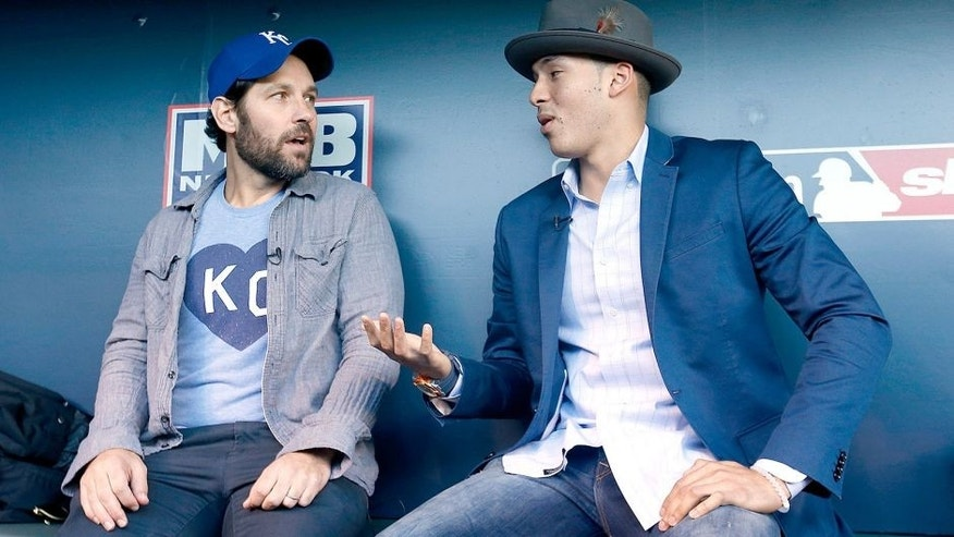 KANSAS CITY, MO - OCTOBER 28: Actor Paul Rudd talks with Carlos Correa of the Houston Astros before Game Two of the 2015 World Series between the Kansas City Royals and the New York Mets at Kauffman Stadium on October 28, 2015 in Kansas City, Missouri. (Photo by Christian Petersen/Getty Images)